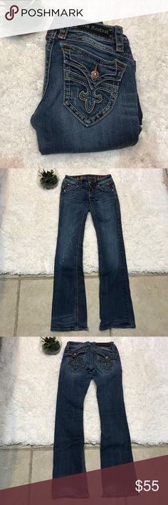 Women's Rock Revival Jeans Size 25 Women's Rock Revival Jeans. Good condition, bottom torn up, Patti boot, size 25. Rise flat approx. 6 1/2in. Inseam flat approx. 31 1/2in. Rock Revival Jeans Boot Cut