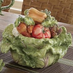 """""""Nature's Bounty Soup Tureen""""     Handcrafted and hand-painted in fresh-picked colors, this 3-D soup tureen will be the hit of the dinner party! Holds 2-qt. Glazed ceramic; hand wash. 11"""" diam. x 8 1/2"""" h, lid on. """