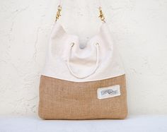 We get a lot of requests for Sandbags with extra features.  We took all of them and put them into this bag.  It looks like a Sandbag, but fancier.    The Refined Sandbag has a natural canvas top and burlap bottom.  It is fully lined with a neutral batik cotton.  There's an interior pocket that's ...