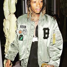 Wiz Khalifa rocks a bomber from his Alpha x Junk Food collab BASH on his Instagram.