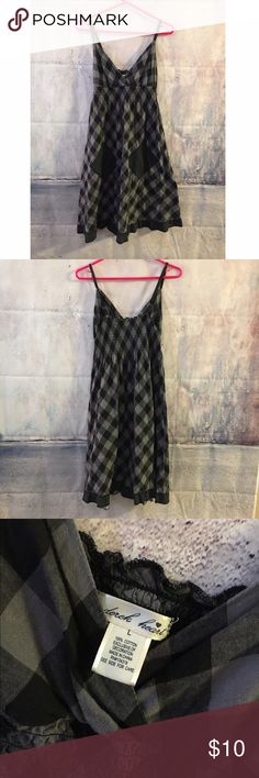 Black and gray checkered dress w/ pockets Black and gray checkered dress with black and gray floral pockets. Spaghetti straps, black. Cuts off about the knee area and be neck top Derek Heart Dresses Midi