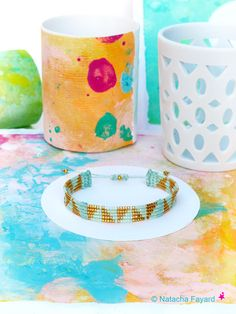Mint & gold graphic woven bracelet - Micro macrame and miyuki delica weaving - Graphic patterns.   © Natach Fayard   #bracelet #set #macrame #MicroMacrame #mint #pastel #gold #miyuki #delica #delicas #graphic #triangle