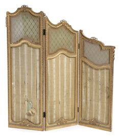 A Louis XVI style giltwood and glass three panel floor screen  late 19th/early 20th century  height 63in; width of panel 21 1/2in