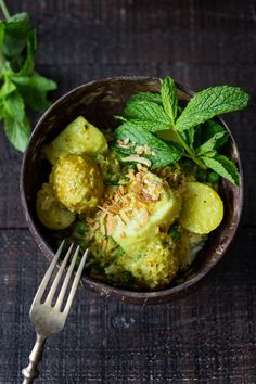 Balinese Fish Curry with potatoes, spring veggies, lime and mint in a fragrant curry sauce.| www.feastingathome.com