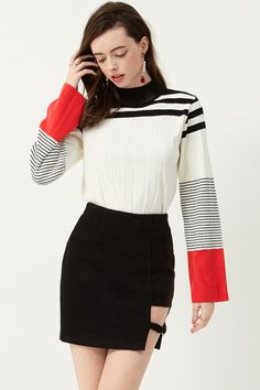 Joy cut-out Skirt . Discover the latest #fashion trends online at storets.com #skirt #pointcut #blackskirt
