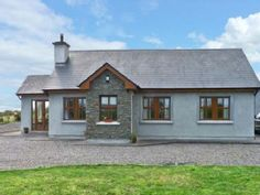 This lovely, single-storey cottage is situated in Cromane, County Kerry, and sleeps six people in three bedrooms. Cottages By The Sea, Home And Away, Ideal Home, Seaside, Ireland, Shed, Outdoor Structures, Cabin, Vacation