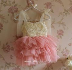 Love this dress ( and the hanger too!)  http://www.b4bubs.com.au/girls-clothing/202-sparkle-layer-rosette-dress.html