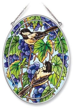 Amia Hand Painted Glass Suncatcher with Chickadee and Grapevine Design, 5-1/4-Inch by 7-Inch Oval by Amia. $19.00. Comes boxed, makes for a great gift. Handpainted glass. Includes chain. Amia glass is a top selling line of handpainted glass decor. Known for tying in rich colors and excellent designs, Amia has a full line of handpainted glass pieces to satisfy your decor needs. Items in the line range from suncatchers, window decor panels, vases, votives and much more.