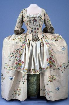 Mantua ca. 1745, Colonial Williamsburg.. Some of these fabrics and patterns are things we would use today as tablecloths etc. We wouldn't dream of wearing them. I saw one dress that looked like the pinafore had been made out of a movers blanket!