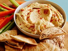 Classic Hummus : Because Katie Lee starts with canned chickpeas, you don't have to worry about soaking and cooking the dried variety, which saves time in the kitchen. She uses a food processor to whirl the chickpeas, bright lemon juice and creamy tahini, plus a pinch of cumin for subtle warmth, into a smooth texture.
