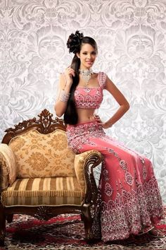 Asian bridal dress in french nett with intricate zardosi work and cystals from swarovki, latest design by fashion designer AD Singh