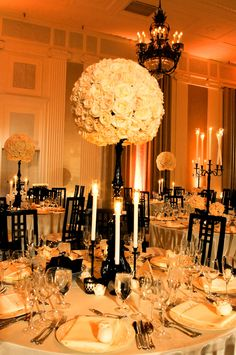 Love the color scheme! soft gold lighting, black candlesticks, white flowers.  photo by Yvette Roman Photography
