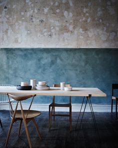 Exactly the sort of furniture and pottery we would sell, also really like the styling in this image. A very simple aesthetic.