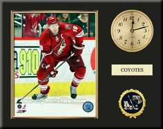 One 8 x 10 inch Phoenix Coyotes photo of Shane Doan inserted in a gold slide-in frame and mounted on a 12 x 15 inch solid black finish plaque.  Also features a 3-inch Arabian gold-faced clock, a customizable nameplate* and a 2-inch hockey medallion with a gold base. $59.99    @ ArtandMore.com