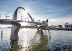 Architects and engineers from Arup Associates teamed up to design this curvaceous pedestrian and cycling bridge