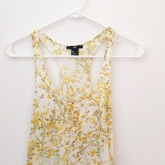 H&M • Yellow Floral Sundress White dress with yellow floral pattern. Looks great on its own or with a black belt. Hem has a slightly high-low cut. H&M Dresses High Low