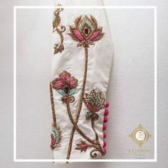 Beautiful white color blouse with lotus flower hand embroidery thread work. 05 April 2018