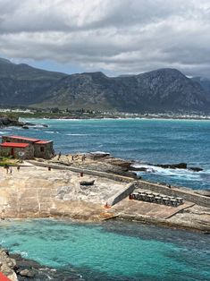 Hermanus town, South Africa. This small Italian alike town is famous for whale watchers, harbour is full of small cozy eateries.