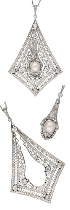 An Art Deco platinum, natural pearl and diamond pendant, French, circa 1920, with https://zen-i-tude.blogspot.frindistinct maker's mark. An intricate pendant composed of two sections, the inner detachable pendant set to centre with a round natural saltwater pearl, approximately 10.4 x 9.0 x 7.9mm in an open back setting, set with old-, eight and rose-cut diamonds, mounted in platinum. Length 9cm. #ArtDeco #pendant