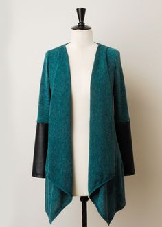 Girl-next-door with a little bit of edge - this ultra-soft & cozy cardi meets its match with vegan leather dipped sleeves. Side pockets ;-) Shop Now http://www.kokoon.net/sweaters-cardis/splice-of-life-cardigan #teal #jade #cardigan #pleather #veganleatheraccents #veganleather #fallstyle #fallfashion #fallsweaters #fallcardigans #longcardi #ethicalfashion #madeinusa #madeinamerica #kokoonfashion #kokoon