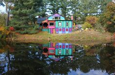 The brightest house in the world. A neglected 19th century farm house has been transformed into a wacky rainbow house, by an artist who used the house as a blank canvas. The farmhouse is located in the middle of the woods in High Falls, N.Y. and looks a fairytale gingerbread house from the outside, hand painted in all the colors of the rainbow. Inside, the quirky house is even brighter, with recycled furniture and chandeliers in each room.