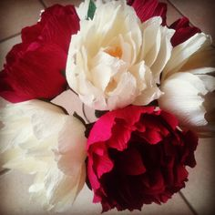 Red and white composition of paper peonies