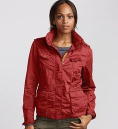 Eddie Bauer -- I just bought this today!  In real life it is not shiny at all.  SO soft and vintage feeling.  I adooore this jacket! On sale for only $49!