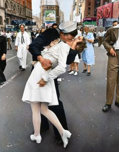 The sailor said later that he was so joyful on hearing of the war's end that he grabbed the nearest person to him!