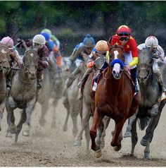 Justify and Mike Smith has the cleanest face on the track . Being on lead . Winners of the Belmont Stakes .