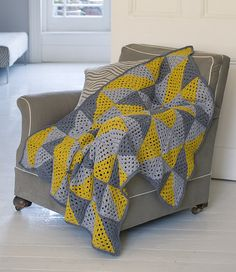 Working two contrasting colours on the diagonal of a granny square creates a dramatic twist. When positioned together, these squares will create a unique blanket with plenty of opportunity for pattern play.
