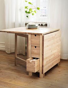 Ikea Norden gateleg table for against chalkboard walk -- extra kitchen storage (cloth towels and napkins?) and fold out flat surface for extra seating/serving space/work space. PERFECT. Either paint or stain????