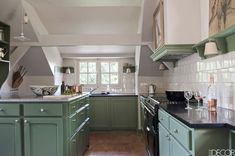 Green cabinets white subway tile backsplash A Renovated Home In Normandy - Franz Potisek Normandy Home - ELLE DECOR Two Tone Kitchen Cabinets, Green Cabinets, Elle Decor Magazine, Apartment Lighting, Brick Flooring, Floors, French Farmhouse, French Country, Custom Cabinetry