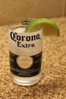 I want this as a glass, use a glass cutter and just cut the neck of the bottles off.