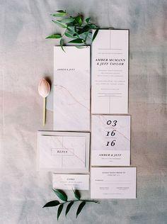 marble wedding invitations - photo by Milton Photography http://ruffledblog.com/industrial-greenhouse-wedding-ideas
