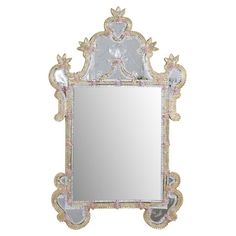 Evoking the romance of Venice, this opulent wall mirror features an ornate frame with dainty floral accents.   Product: Mirror