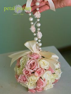 For the flower girl. Since its so hard for flower girls to keep ahold of there flowers. Why not tye a ribbon and some pretty beads to the bouquet and tye it around the flower girls wrist or waist.