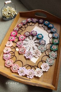 displaying crocheted hair bands and clips