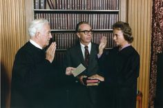 First Woman Justice, Sandra Day O'Connor Being Sworn in a Supreme Court Justice by Chief Justice Warren Burger, Her Husband John O'Connor Looks On. 9/25/1981