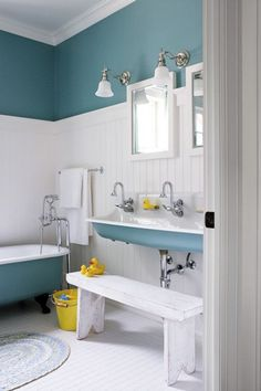Kids Bathroom Design With Blue And White Paint Color And Ceramic Tile And Alluring Bathtub And Free Standing Sink