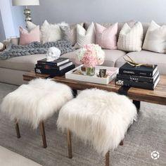 living room. sheepskin stools.