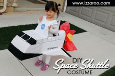 when you make a purchase by clicking through our links. Read our disclosure policy here.) We had so much fun making this DIY kids space shuttle halloween costume for our little girl and we're happy to be sharing it with you. This costume was 1 of 4 space themed costumes we made for our family this year. Here's what you'll need and how to make it: Supplies: Cardboard Packing tape White card stock paper White fabric Black felt Black paper cups Red and yellow tissue paper Pip...