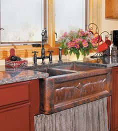 Love this copper sink with hand-hammered forest scene on the front, and the deep bowls for canning.