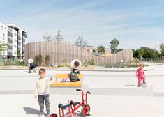 Timber-clad kindergarten by Behnisch Architekten opens in new plaza
