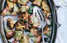 Pot-Roasted Artichokes...I serve this appetizer/side dish with fresh squeezed lemon juice, Parmesan cheese and toasty bread pieces