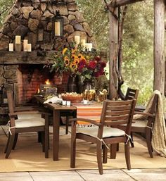LOVE this outdoor fireplace w/ reclaimed mantel