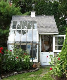 The ideal garden accessory - a combination greenhouse/potting shed.