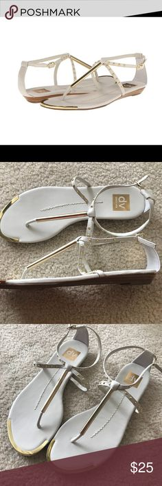 "DV by Dolce Vita Apollo Women's Sandals, Bone NWOT Add a splash of rock and roll rebellion to your look with these wicked sandals! ; Thong-style construction with adjustable buckle closure at ankle strap. Faux leather upper with hardware accent at T-strap and sleek stud detail. Man-made lining. Lightly cushioned man-made footbed. Metallic hit at toe pad adds visual appeal. Man-made sole. Imported. Measurements: ; Heel Height: 3/4""  These would look great with a pair of jeans or a summer…"