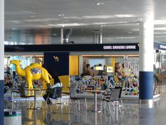 Smoking room in Munich airport. Liking the bright yellow camel decor...