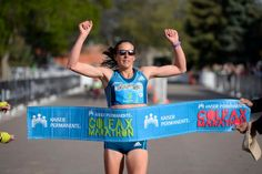Description of . Brianne Nelson wins the women's 1/2 marathon with a time of 1:16:07 during the 9th annual Colfax Marathon May 18, 2014. The 26.2 mile Marathon runs through Denver's iconic landmark Mile High Stadium (twice), Sloan's Lake, City Park, Colfax Avenue through Lakewood and Aurora. The Marathon started and finished in City Park where runners enjoyed the rest of the day listening to music by Chris Daniels and the Kings. (Photo by John Leyba/The Denver Post)