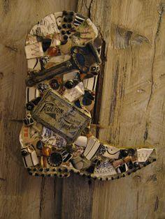 Mosaic cowboy boot with rusty hardware and ink pad tin, mosaic art.